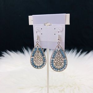 Silver and blue dangling oval shaped earrings